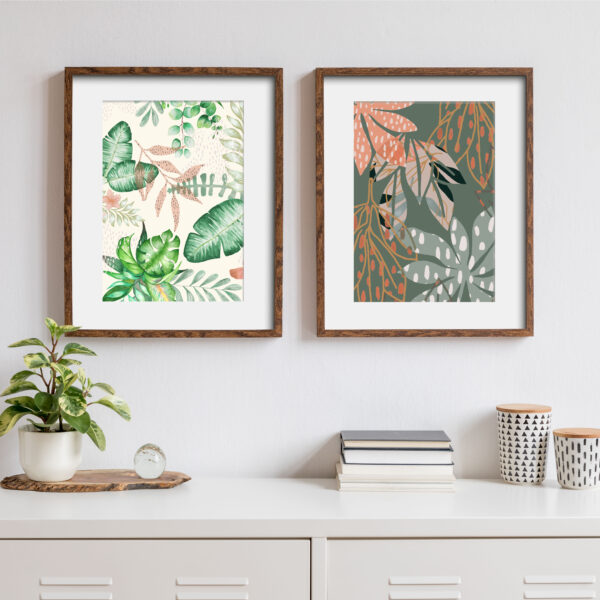 Megan Rose Designs, Jungle droplets and green dropping leaves prints, green and pink tropical botanics, in wooden frames on a white wall in a modern scandi white home interior
