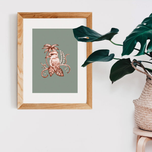 Megan Rose Designs, Green Kookaburra print in wooden frame with cheese plant on white background