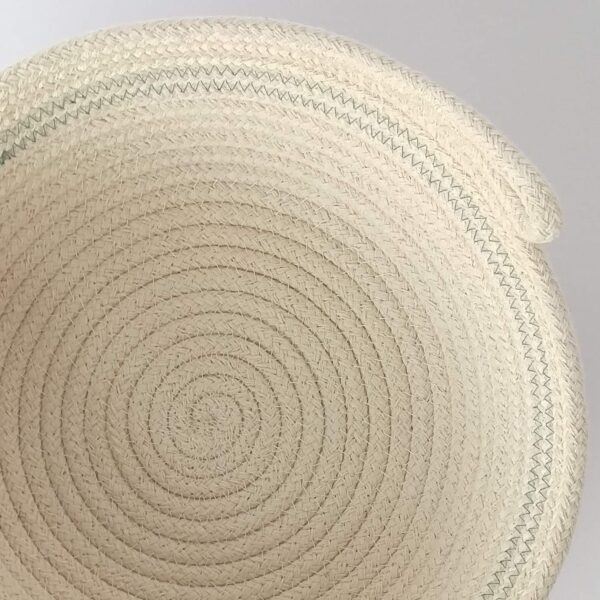 Overhead view of a bowl formed from a coil of cotton rope