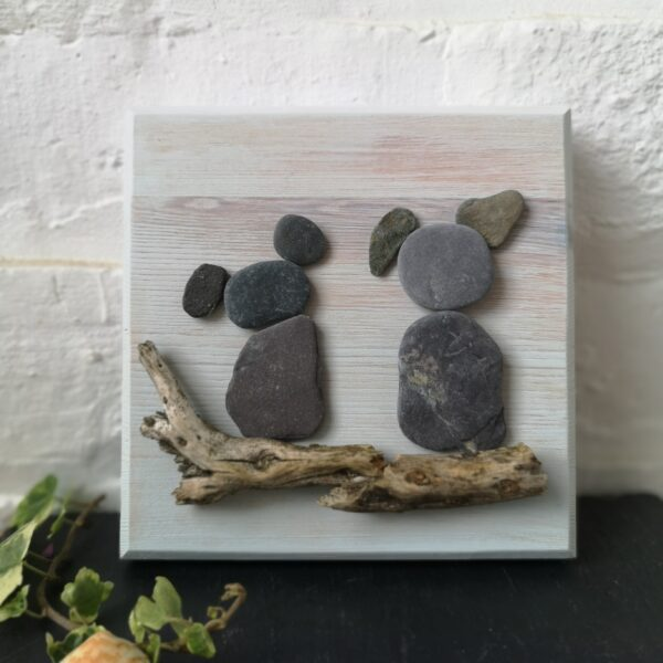 Ivy Upcycling Pale Blue Plaque with Pebble critters gazing into the horizon sat on a beach combed wooden branch