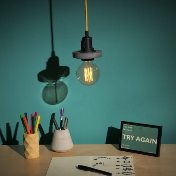 Mexish Made, Hanging Lamp, Yellow Pen Pot, Grey Pencil Pot on desk with Try Again photo
