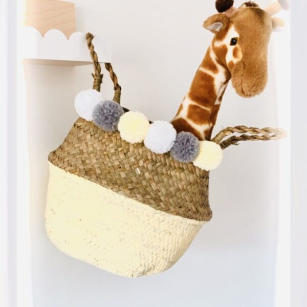 tural Seagrass basket with yellow, white and grey pom poms.