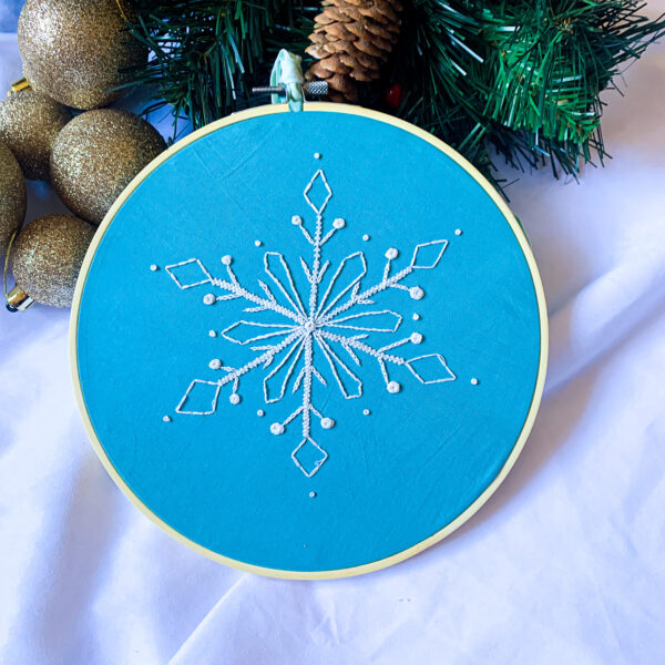 Wild Strings by Eleanor, white snowflake embroidery hoop