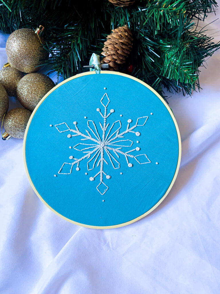 Wild Strings by Eleanor, white snowflake embroidery hoop