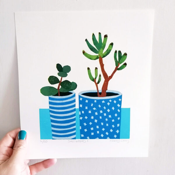 Kerry Day Succulents No 1 Lino Print, a Still Life of 2 succulents in blue stripy and spotty plant pots