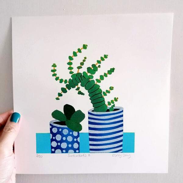 Kerry Day Succulents No 2 Lino Print, a Still Life of 2 succulents in blue stripy and spotty plant pots