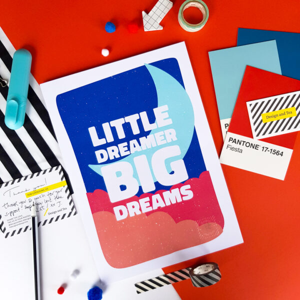 Design and Tea, sweet colourful inspirational print 'Little dreamer big dreams' with bold white lettering on a blue background with a light blue moon and red and orange clouds. Perfect for a kid's nursery or playroom.