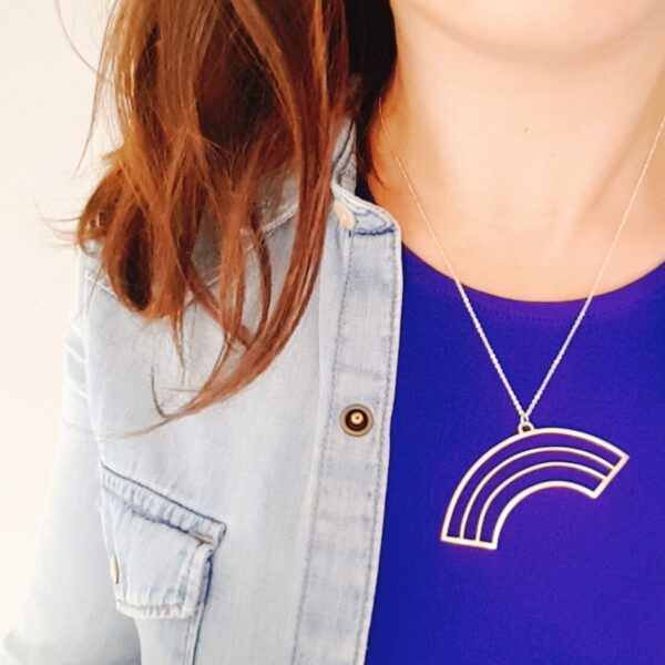 KiJo Jewellery, Gold rainbow necklace on silver chain worn on contrasting blue top