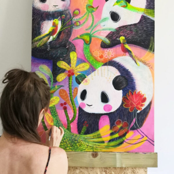 Jo Rose Studio, Jo painting a large original painting of pandas and peacocks, very bright and colourful.