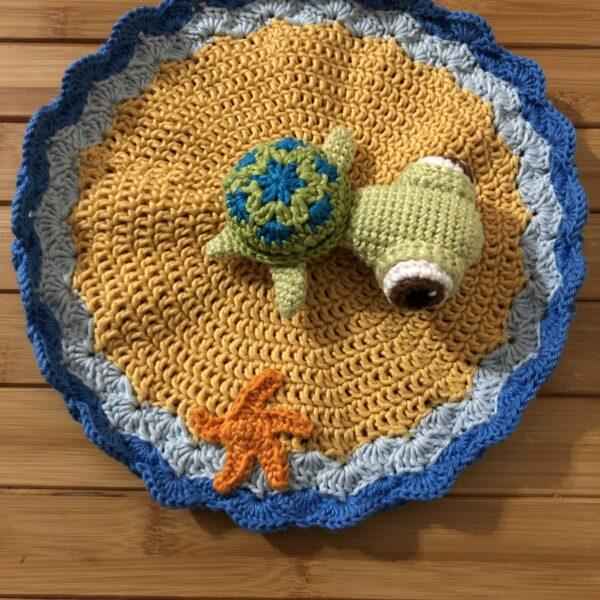 504 Krafts by K, Baby turtle comforter on island with orange starfish