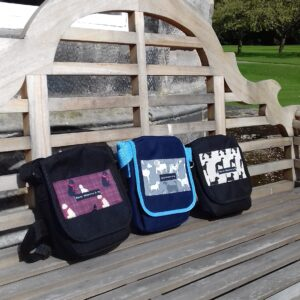 bertiewoofsterandme,dogwalking bags on location on a wooden bench,three designs
