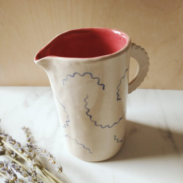 victoria ceramics, handmade stoneware jug with painted flowers and a scalloped handle