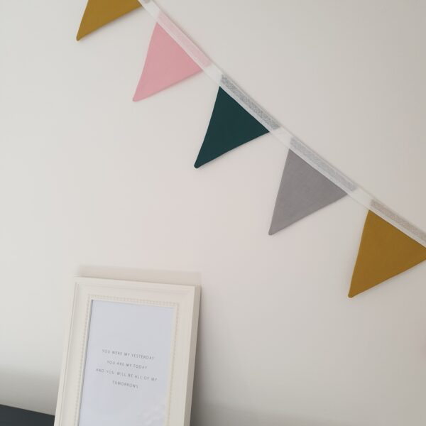 Surtees and Co Willow bunting with bottle green, mustard, grey and candy pink flags for decorating walls