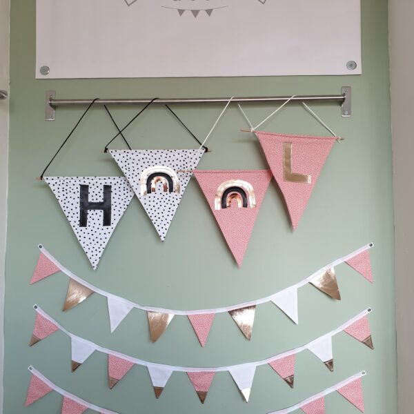 Surtees and Co Market set up from home featuring pink speckle and dalmation spot fabric wall hangings and bunting
