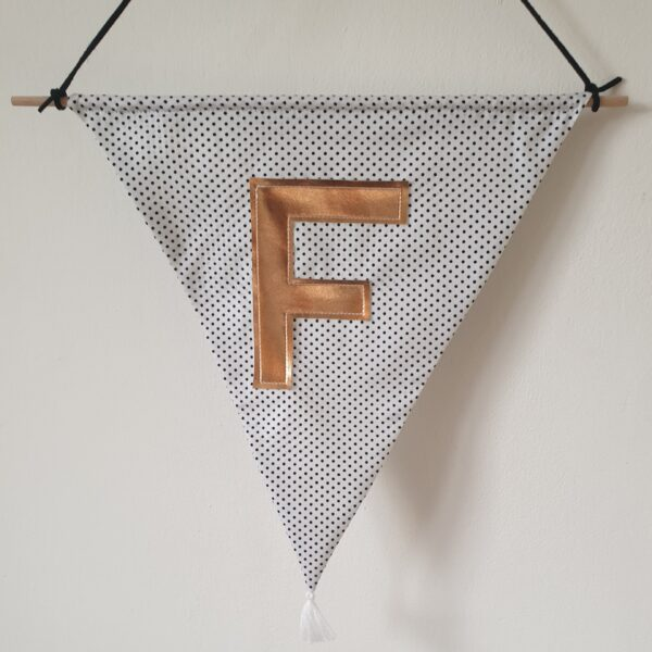 Polka dot monochrome wall hanging with copper initial detail