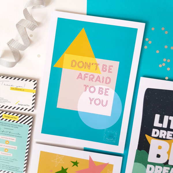 Design and Tea, flat lay of 'Don't be afraid to be you' colourful inspiring typographic print with teal background, shapes in yellow, grey and teal colour and text in pink colour