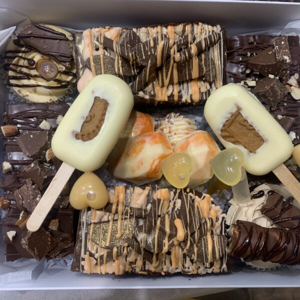 Chocolate lovers gift box with boozy brownies, boozy cakesicles, boozy geo hearts and tipsy cupcakes
