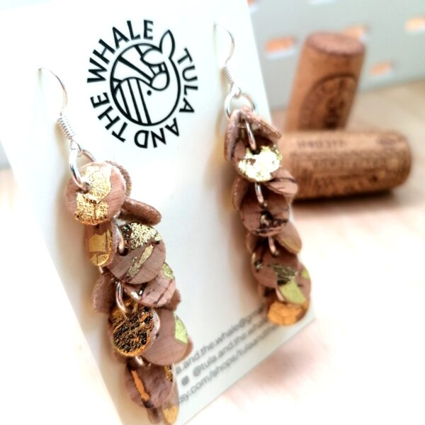 Tula & the Whale vegan cork leather drop earrings with gold leaf design on a white business card