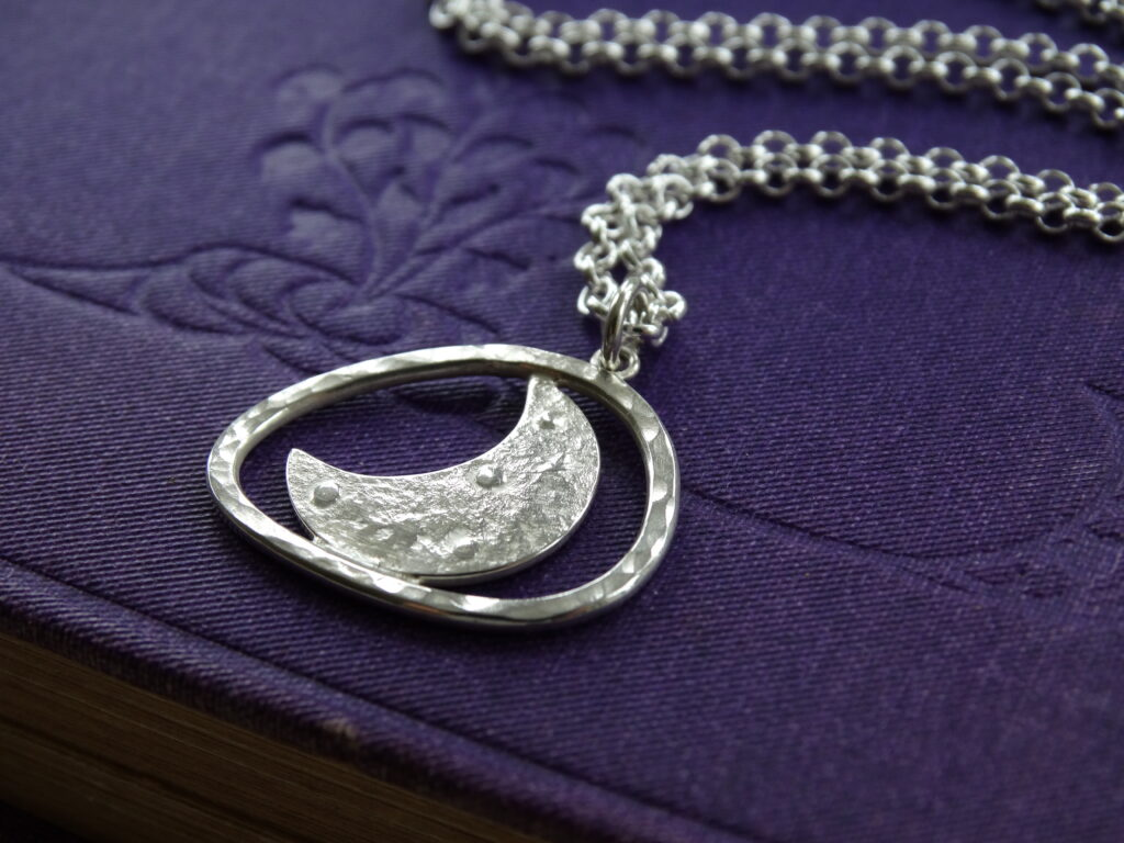 Embossed textured crescent moon pendant in recycled silver by silver nutmeg