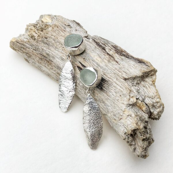 76 Silver, Contemporary Cornish Sea-glass and Stirling silver earrings featuring textured silver leaf drop