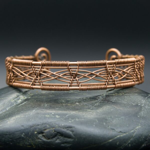 Oruki Design, Copper wire woven double cross cuff bracelet, on grey stone with black background