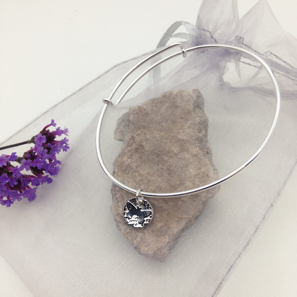 Firetree,Butterfly Bangle, adjustable sterling silver bangle with butterfly charm.