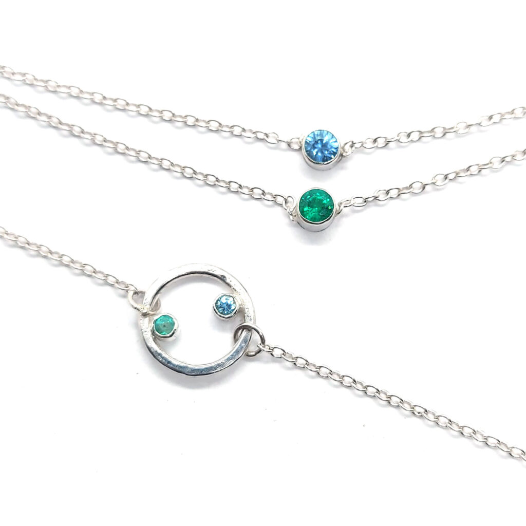 Circle bracelet and double necklace with emerald and blue zircon birthstones Mijoux Creations