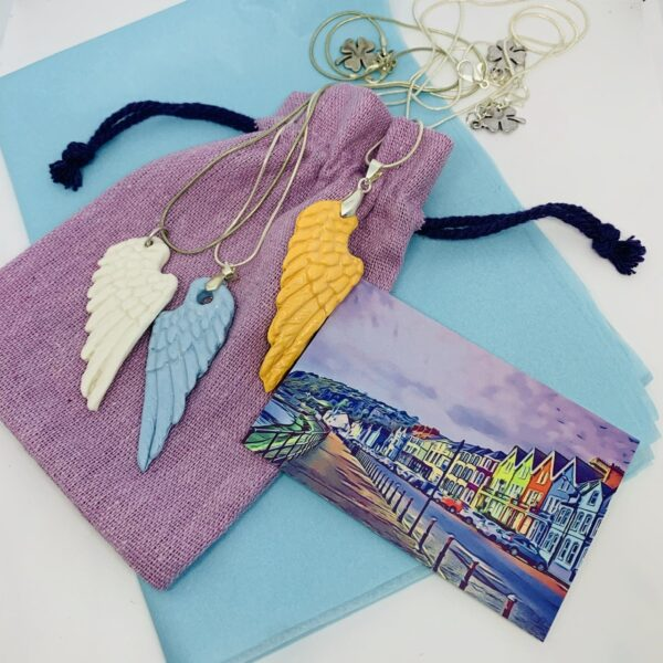 Grace Louise Ceramics coloured angel wing pendants on silver plated necklace with lucky charm on the clasp Comes in a beautiful keepsake linen bag necklace length 18 inches