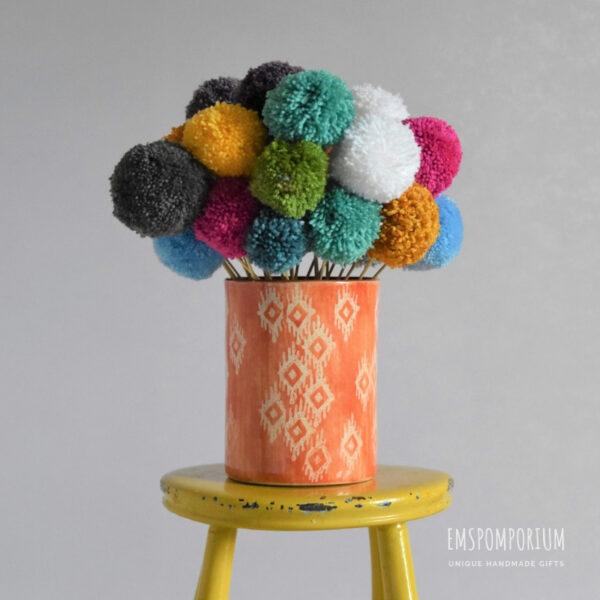 Pom pom flowers, bouquet, flowers, colourful, yellow stool, orange vase.