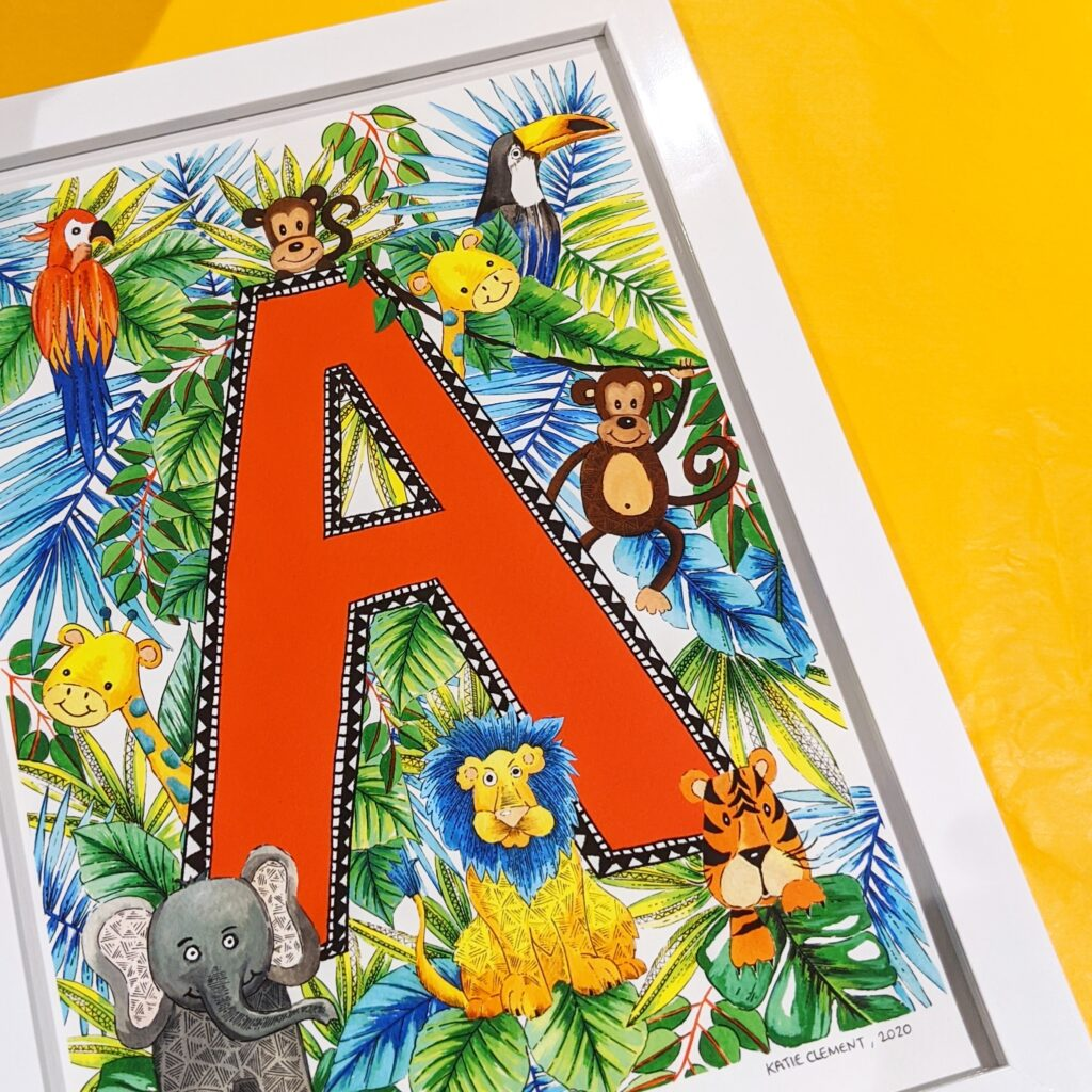 Katie Clement Illustration, a framed A4 letter A Children's Jungle Initial Art Print lays flat on some yellow tissue paper