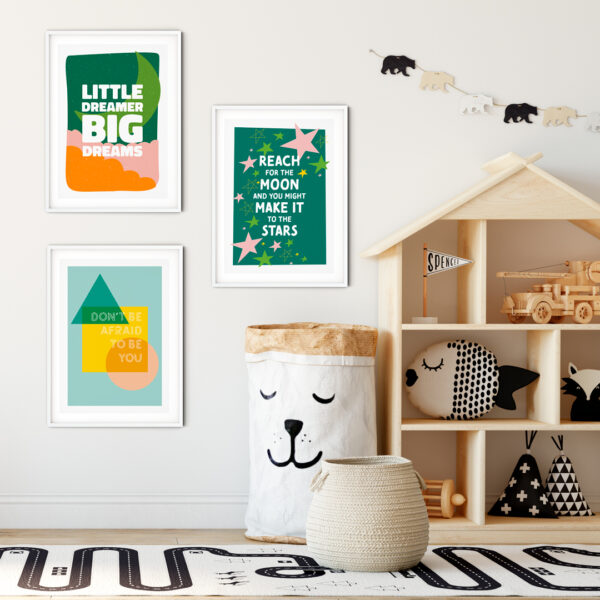 Design and Tea, Trio of colourful inspiring typographic prints shown in a child's bedroom. Including Little Dreamer Big Dreams, Don't be afraid to be you and Reach for the moon and you might make it to the stars in colours green, pink, orange, yellow and teal.