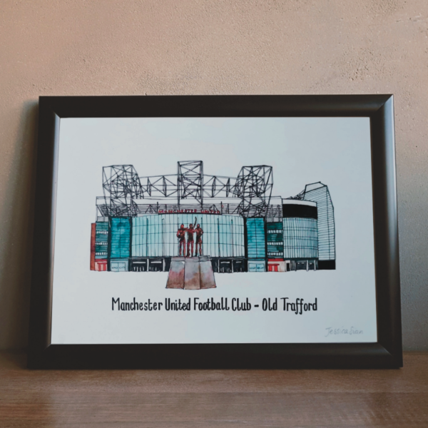 Jessica Sian Illustration, Manchester United stadium drawing and watercolour painting drawn by hand in fineliner pen and then painted with watercolour paints. The piece is in a black frame