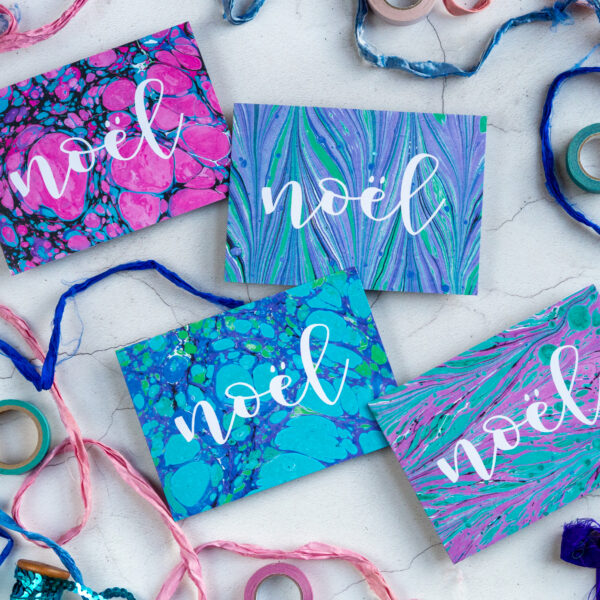 The Eloise Bindery, colourful pink, purple and blue marbled Noel christmas cards