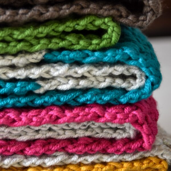 Crochet Snoods, infinity Scarves, colourful. Stack of 4 scarves, green, brown, jade, silver, pink, mustard. Crochet scarves.