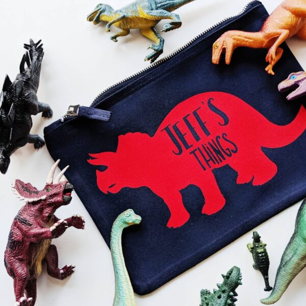 Grizzli Bear, custom red triceratops dinosaur pouch
