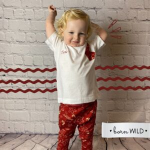 child in personalised handmade Christmas pyjamas