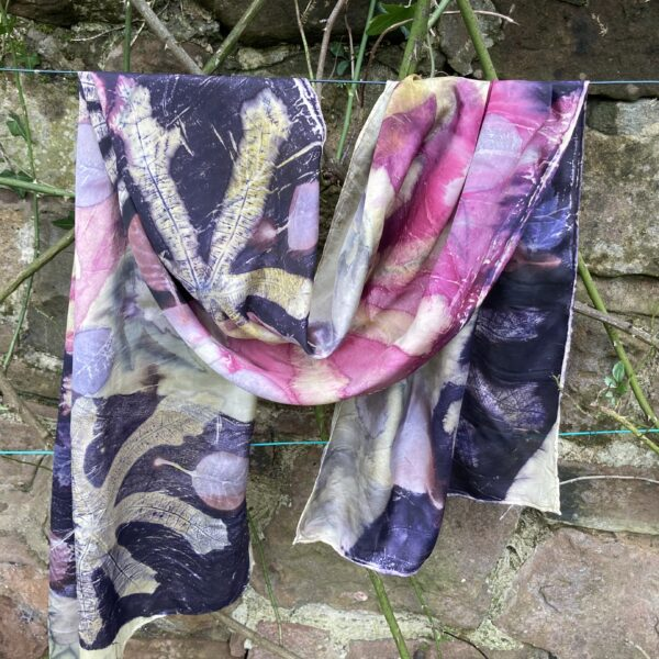 By Maggie Naturally. Large silk scarf/shawl, hand printed with fig leaves, cotinus and acers, handdyed with weld, logwood and cochineal