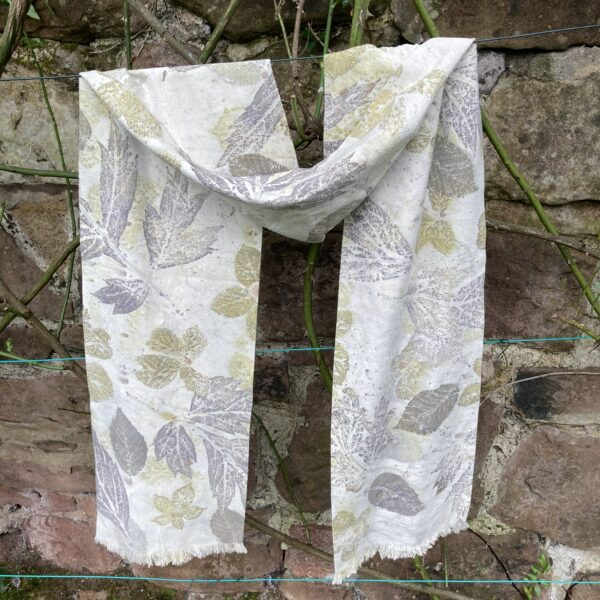 By Maggie Naturally. Silk noil ['raw silk'] double thickness scarf, hand/ecoprinted with mixed summer leaves including tree paeony, blackberry and hazel.