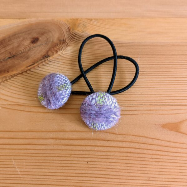 Button hair bobbles covered with handwoven fabrics by Up North Textile Design