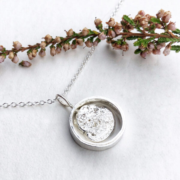 76 Silver- spinning pebble pendant