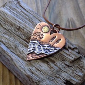 Copper and silver mixed metal heart pendant