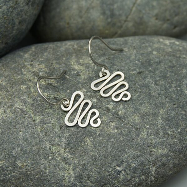 Oruki Design - Hammered Silver squiggle earrings on grey stone