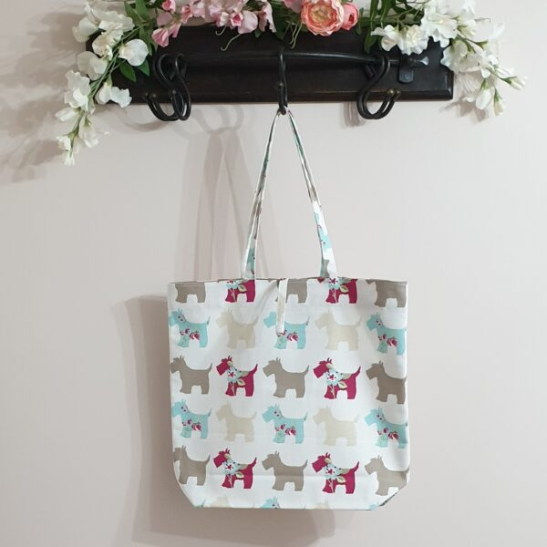Large tote bag with stylised red, blue and neutral scottie dogs with flowers