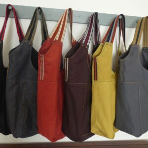 needle in the mill, bucket tote. Made from a dry oilskin, lined with an internal pocket.