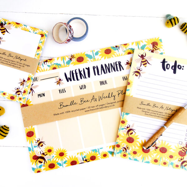A collection of three recycled eco friendly bumble bee notepads