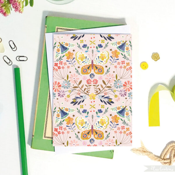 eco-friendly greetings card by bee brown illustration featuring butterfly and moth pattern in pink & blues with a green pencil and buttons and book