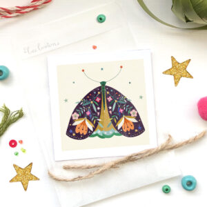 miniature art print by bee brown illustration printed onto FSC approved paper and hand finished with gold ink, with a glassine bag and surrounded with stars, beads and ribbon