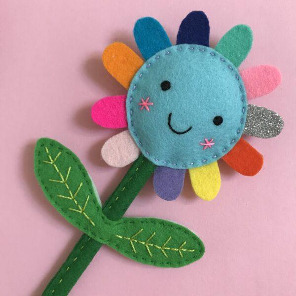 Shirley Rainbow Handmade Felt Flower with a smiley face