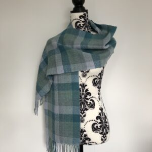 A plaid scarf in beautiful green shades with a twisted fringe