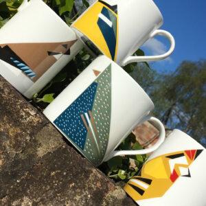 Twenty Birds 4 Bird mugs on wall. Including Starling, Goldfinch, Blue tit and Jay